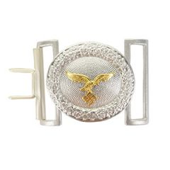 Front view of oval shaped silver belt buckle with golden eagle in the middle