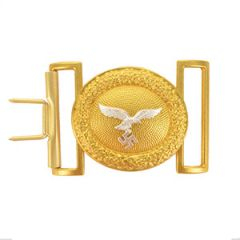 Front view of oval-shaped gold belt buckle with silver eagle in the middle