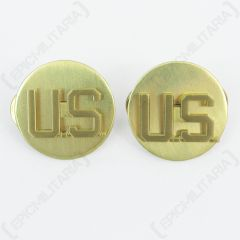 Front of pair of round, gold American EM Collar Discs both with U.S. in the middle