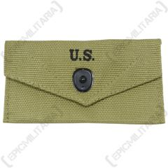 Front of khaki canvas American Khaki First Aid Pouch with one black popper style button closure. The closure flap has U.S. stamped in black in the middle