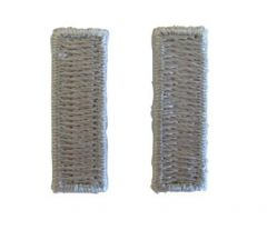 Front of pair of grey silver coloured, woven, horizontal First Lieutenant Officer Rank insignia
