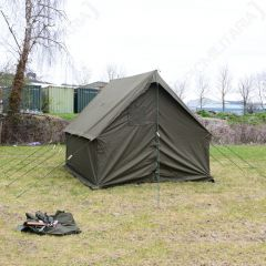 Green tent in a field