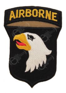 Shield shaped dark brown embroidered patch with right-facing eagle head, white with black eye, yellow beak, and red tongue. Attached to the top of the shield is a dark brown arch with AIRBORNE in golden yellow