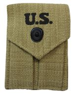 Front view of khaki M1923 Colt Ammo Pouch with black popper style button closure and U.S. stamped on the top in black