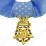 Close up of US Medal of Honor, gold medal on light blue fabric
